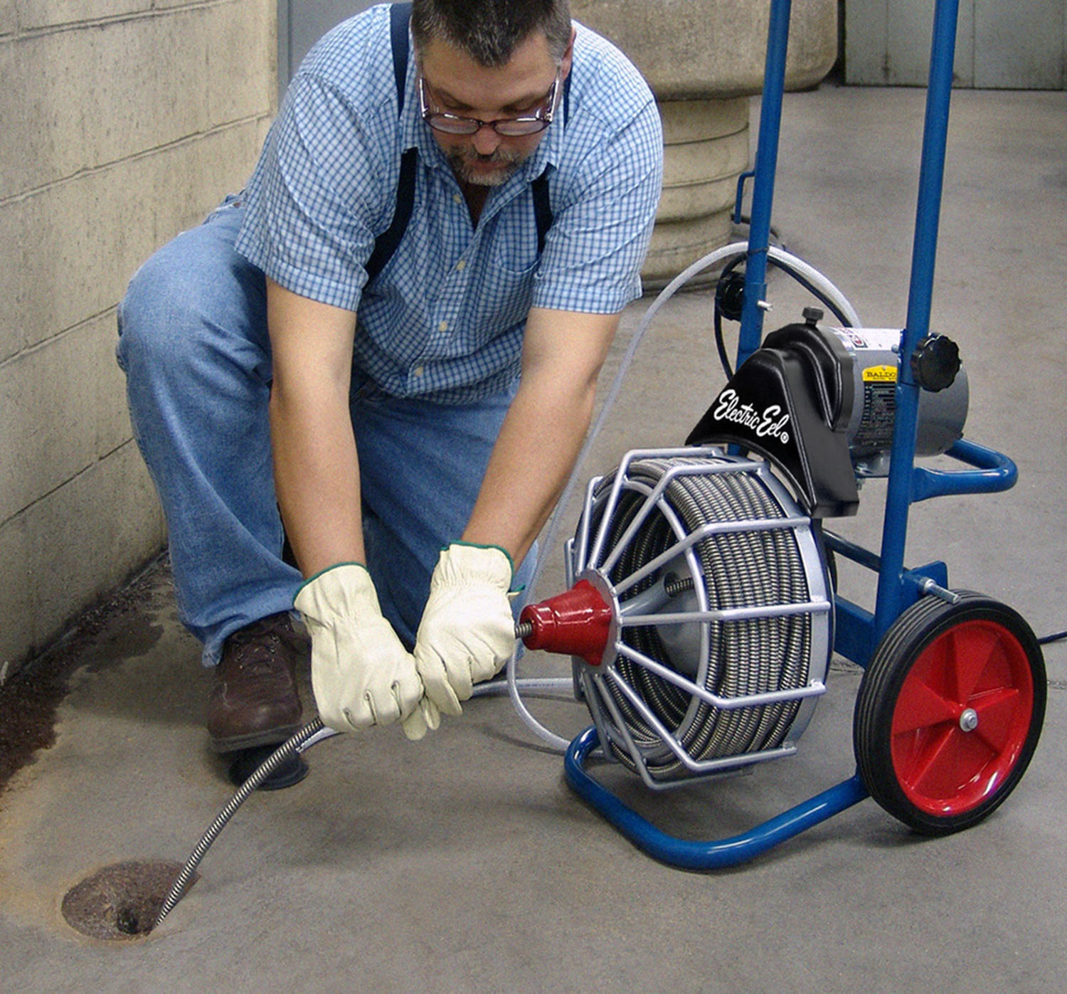 This drain cleaning machine features 2-way auto cable feed with hands off rotating cable for added safety.